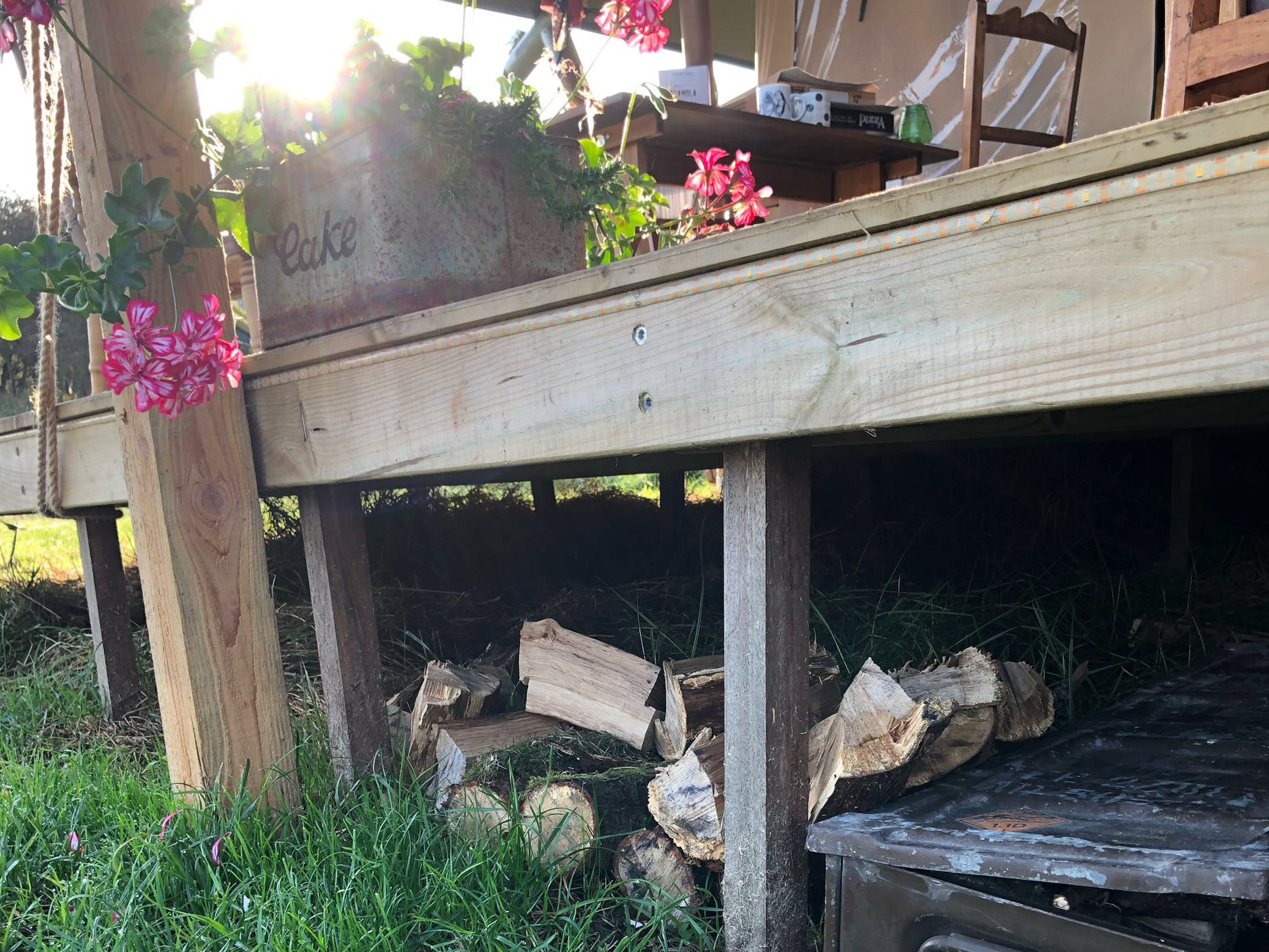 Flowers and firewood, ready for a weekend glamping