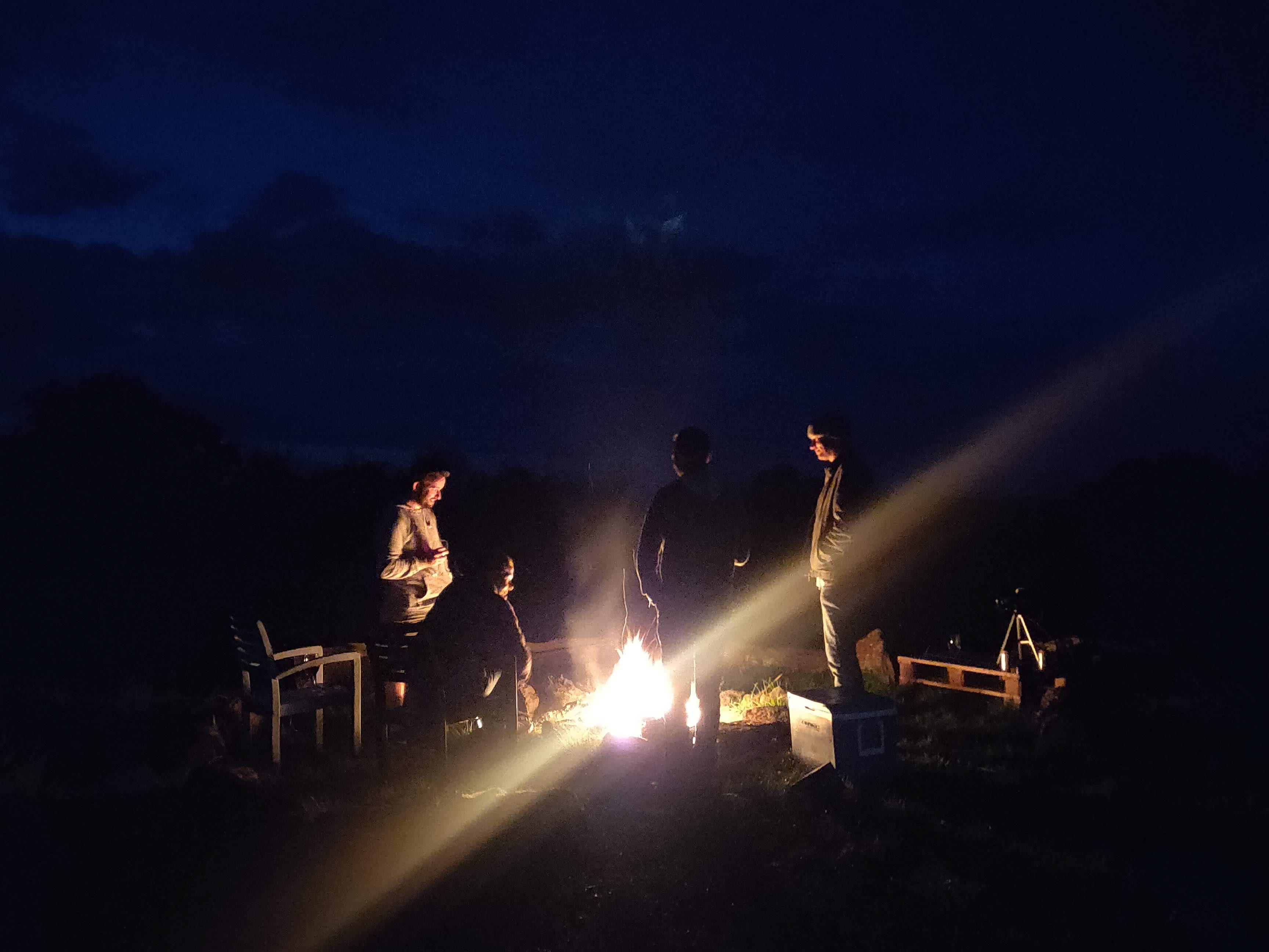 Around the fire at night