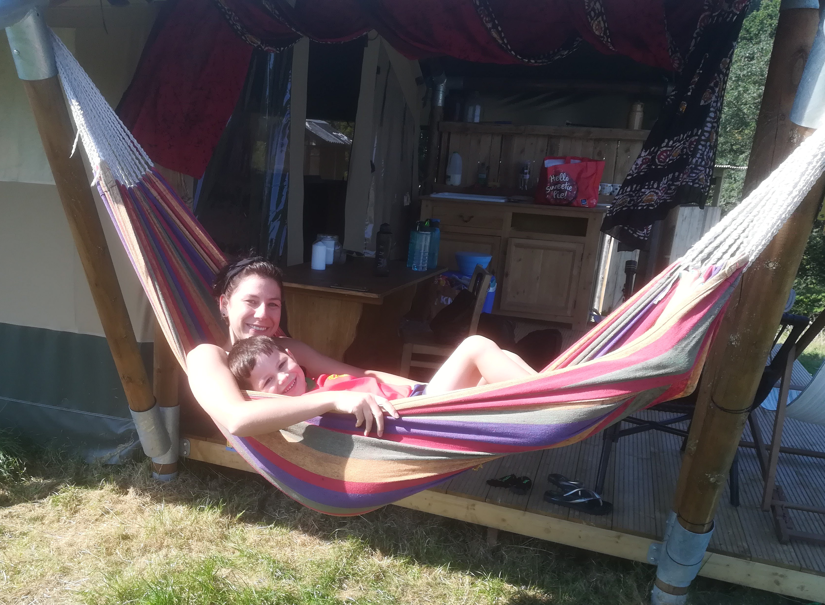 Mum and daughter relaxing in a hammock