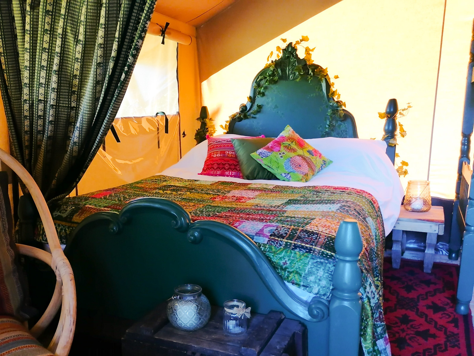 The bed in the Wild Woods safari tent