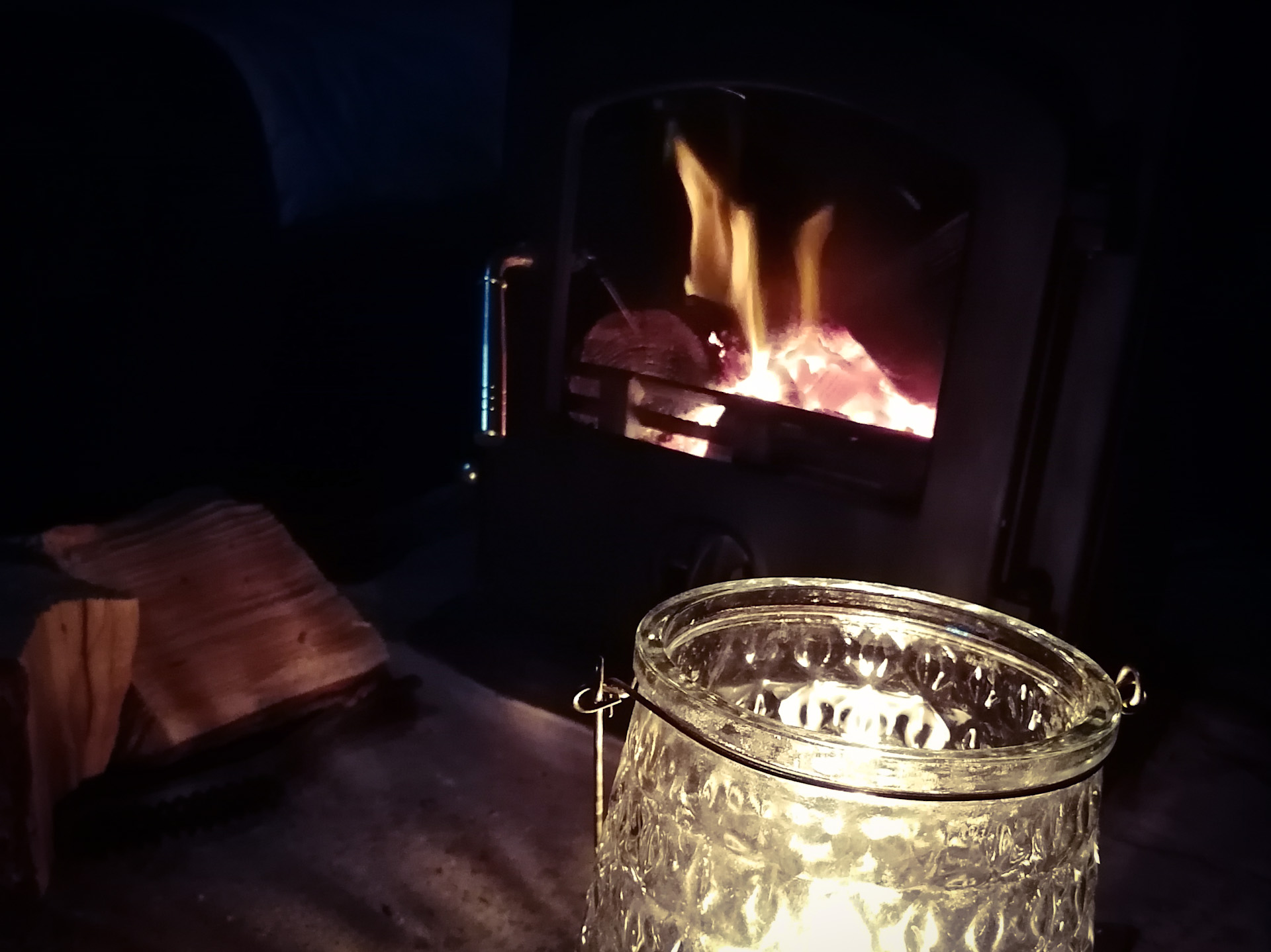 A candle and the log burner